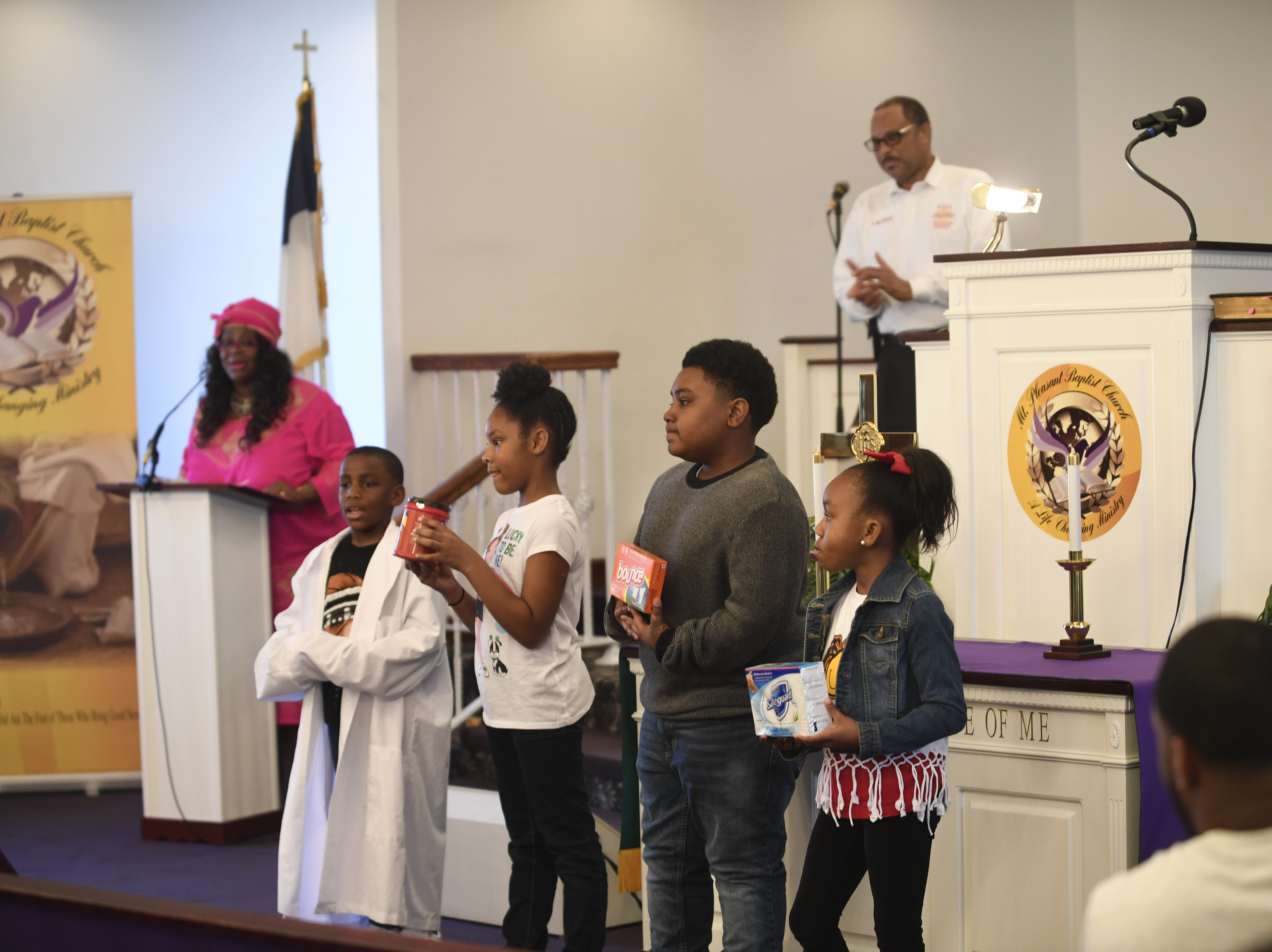 A group of kids from Mt. Pleasant Baptist Church show off some famous products created by African-Americans during a Black History Month event in Pinson, Tenn. Feb 24, 2019.