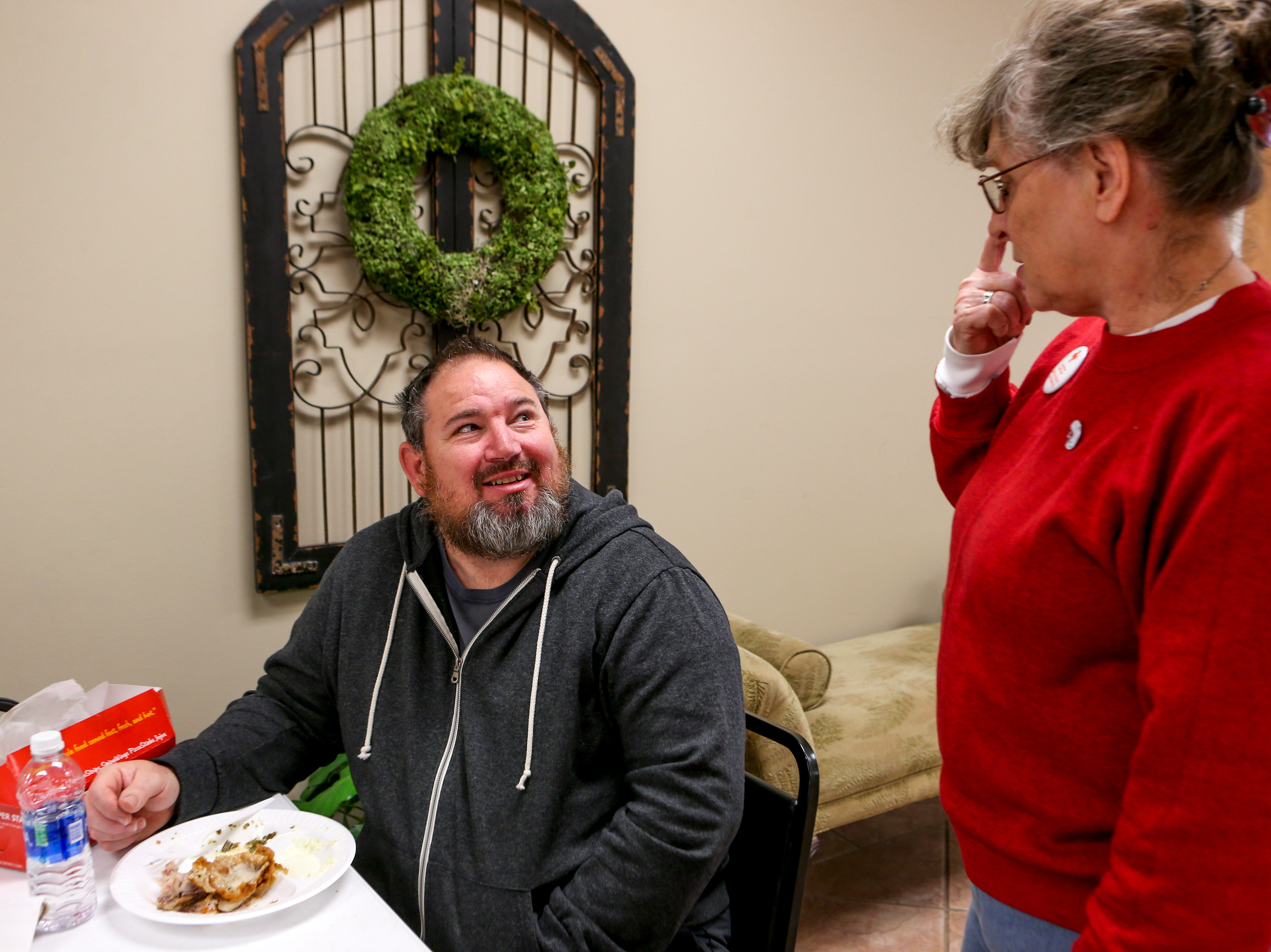 Jackie, right, a volunteer for The American Red Cross, asks Frank Taylor, a Savannah resident that lost everything after flood waters overtook the home he just finished modeling, what were his glasses prescriptions so they can get him a new pair after Taylor mentioned he had lost his in the water at Savannah Church of Christ, in Savannah, Tenn., on Monday, Feb. 25, 2019.