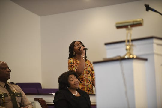 Kelsey Mercer leads the crowd in song during Mt. Pleasant Baptist Church's Black History Month event Feb. 24, 2019, in Pinson, Tenn.