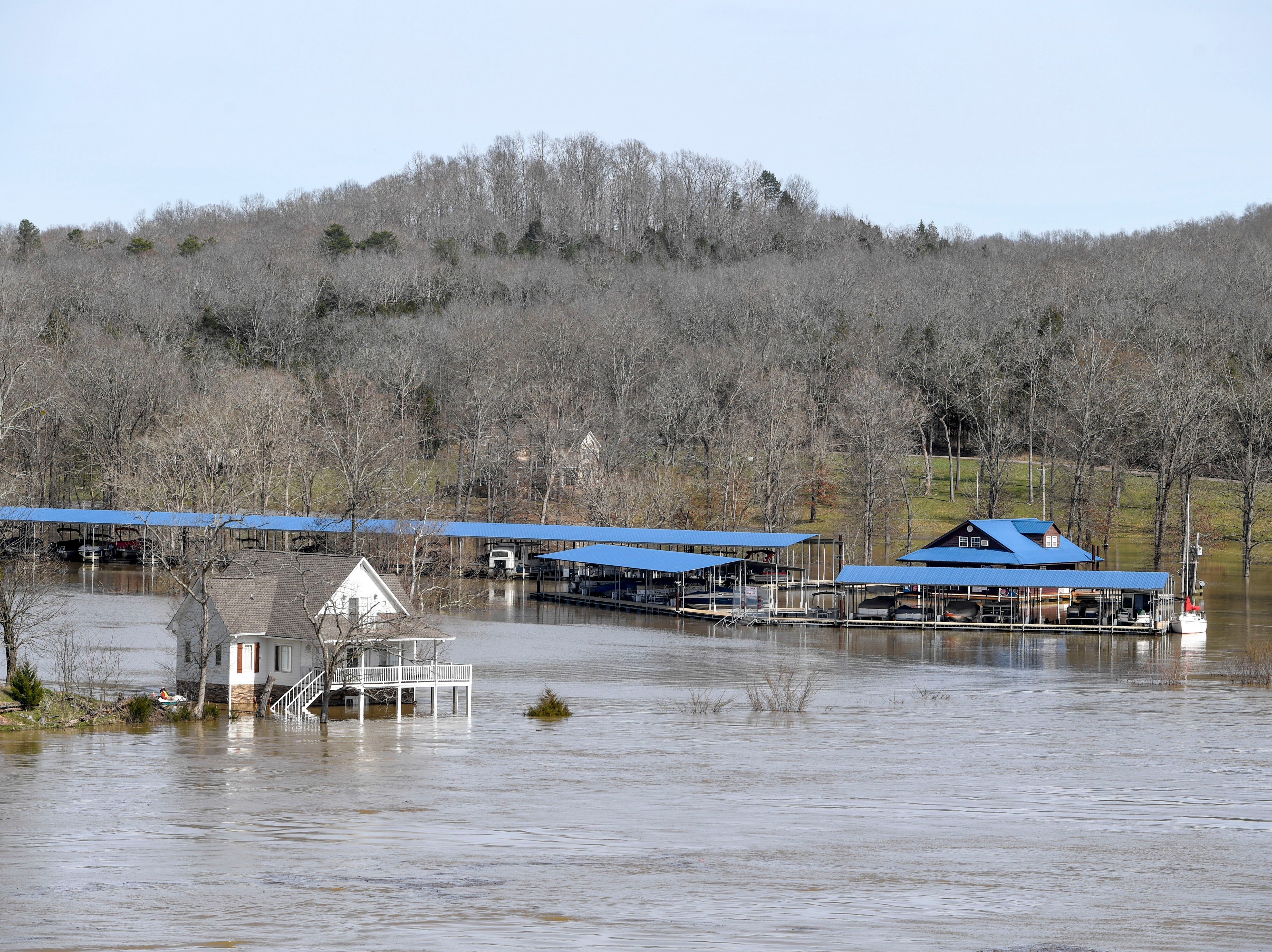 A marina and buildings around the Tennessee River are overcome by rising waters at US-641, in Decaturville, Tenn., on Monday, Feb. 25, 2019.