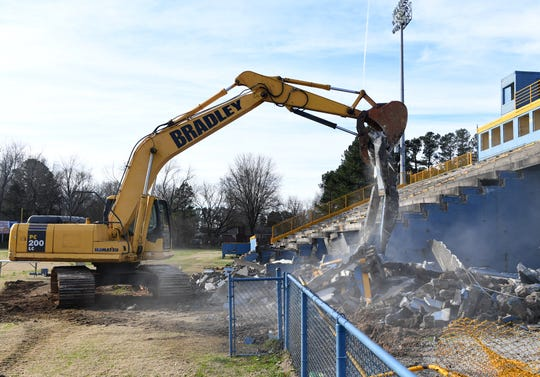An excavator demolishes portions of the North Side High School stadium home-side bleachers, Tuesday morning, Feb. 26.