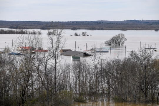 Homes along the Tennessee River are submerged up to the porch, some all the way to their roof after flood waters overtook them at Tennessee River Bridge, in Savannah, Tenn., on Monday, Feb. 25, 2019.