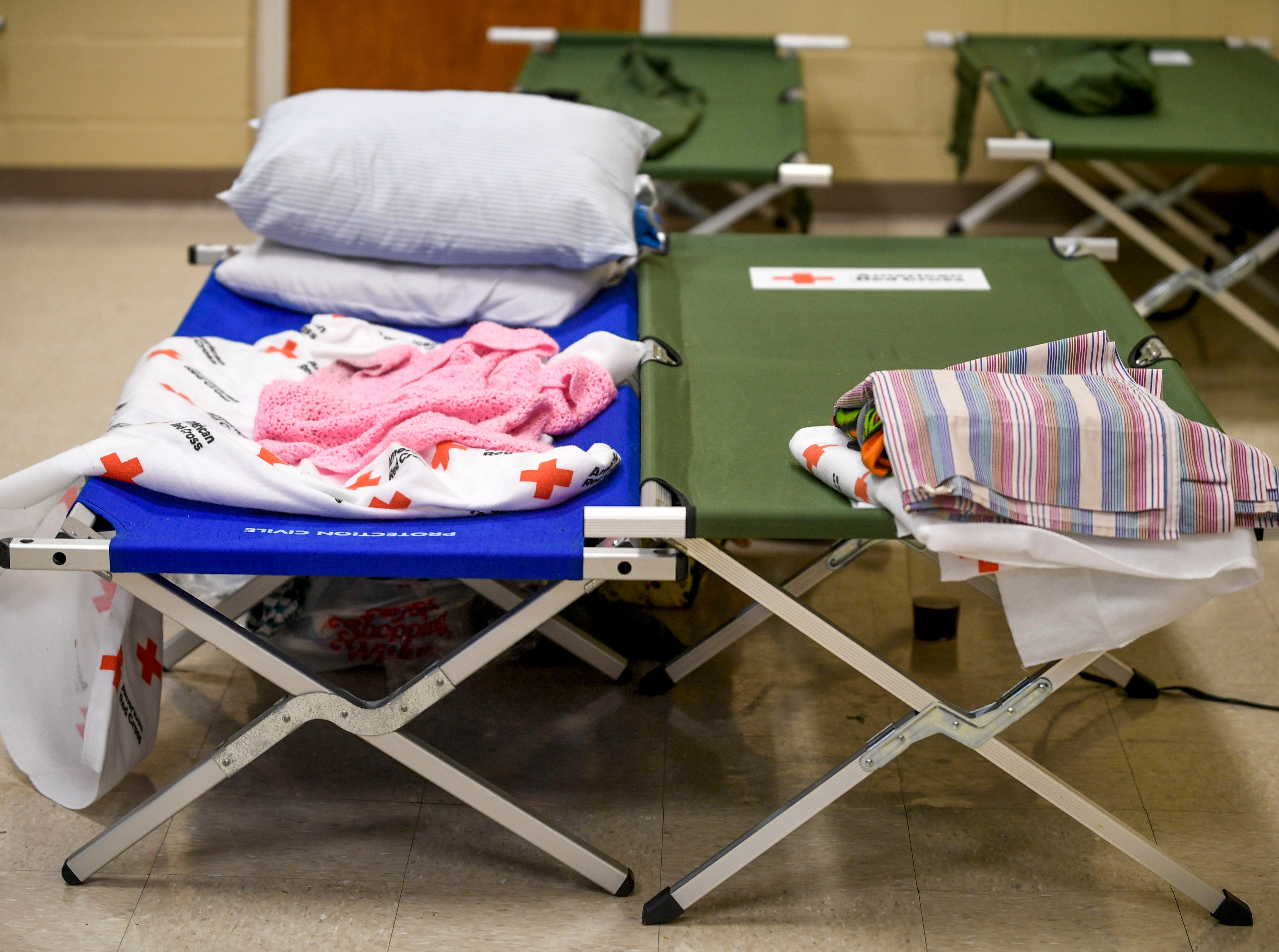 Cots in use are draped with blankets and belongings of this seeking shelter at Savannah Church of Christ, in Savannah, Tenn., on Monday, Feb. 25, 2019.