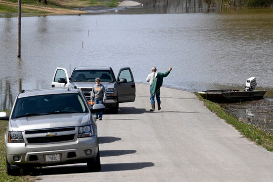 Clifton, right, and Dot Exum, both from Jackson, prepare to board a small boat they will take to check on their property in the flooded area at Lost Creek Boat Ramp, in Decaturville, Tenn., on Monday, Feb. 25, 2019.