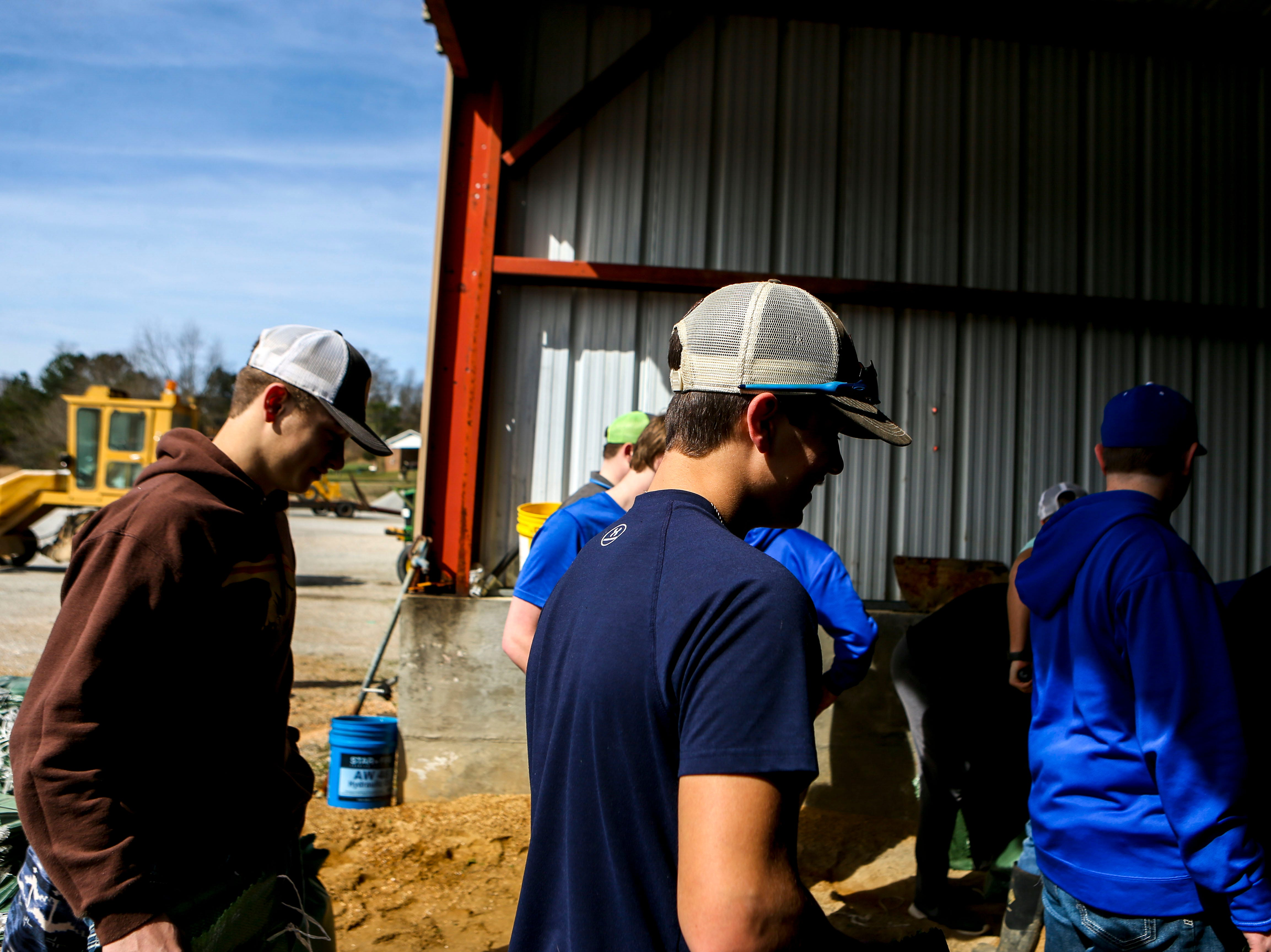 Riverside High School football and baseball players fill up sand bags for distribution to residents that may need them at Decatur County Highway Department, in Decaturville, Tenn., on Monday, Feb. 25, 2019.