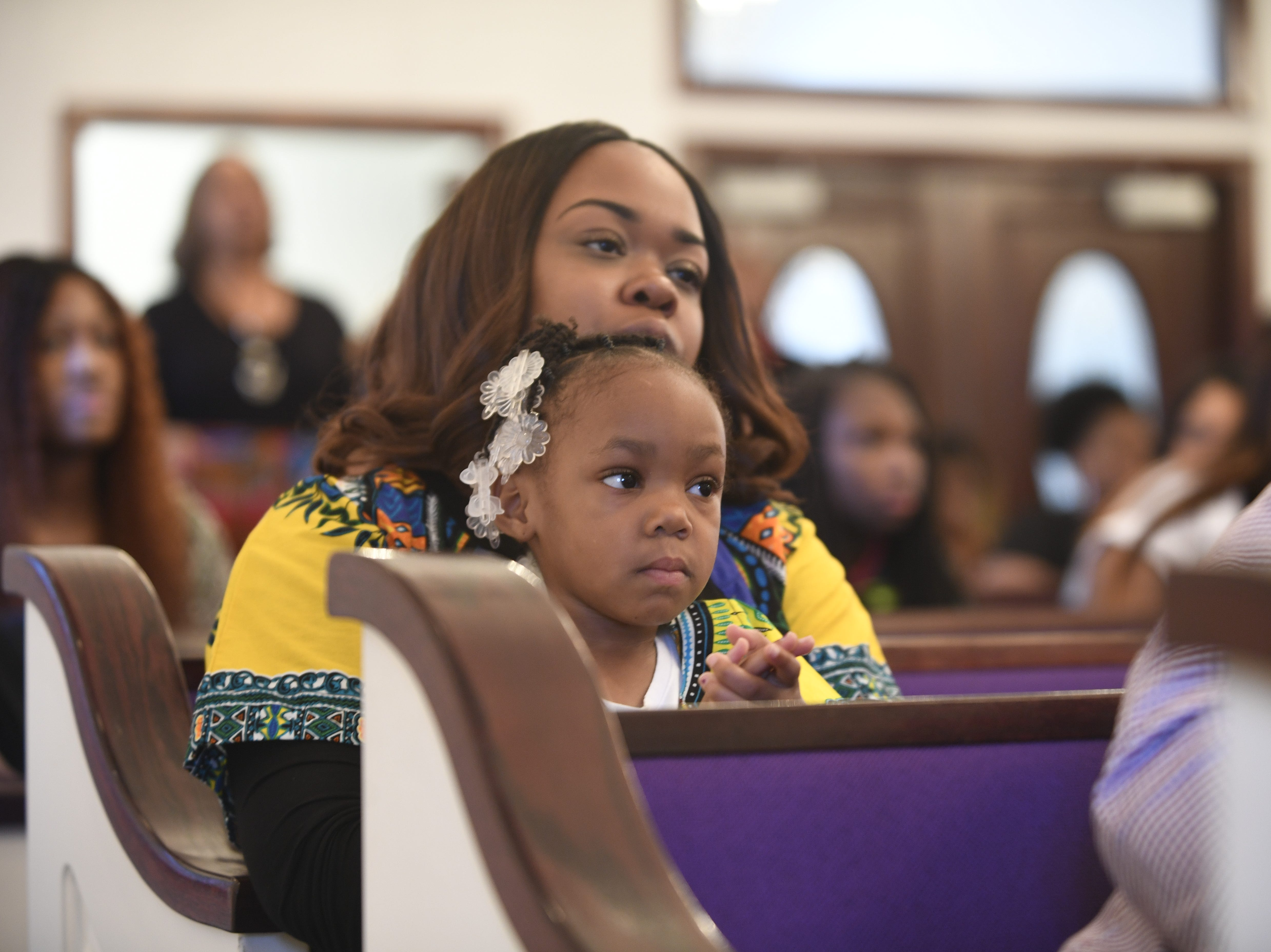 Chernae Anderson and her daughter Ava listen to the speakers during Mt. Pleasant Church's Black History Month event, in Pinson, Tenn. Feb 24, 2019.