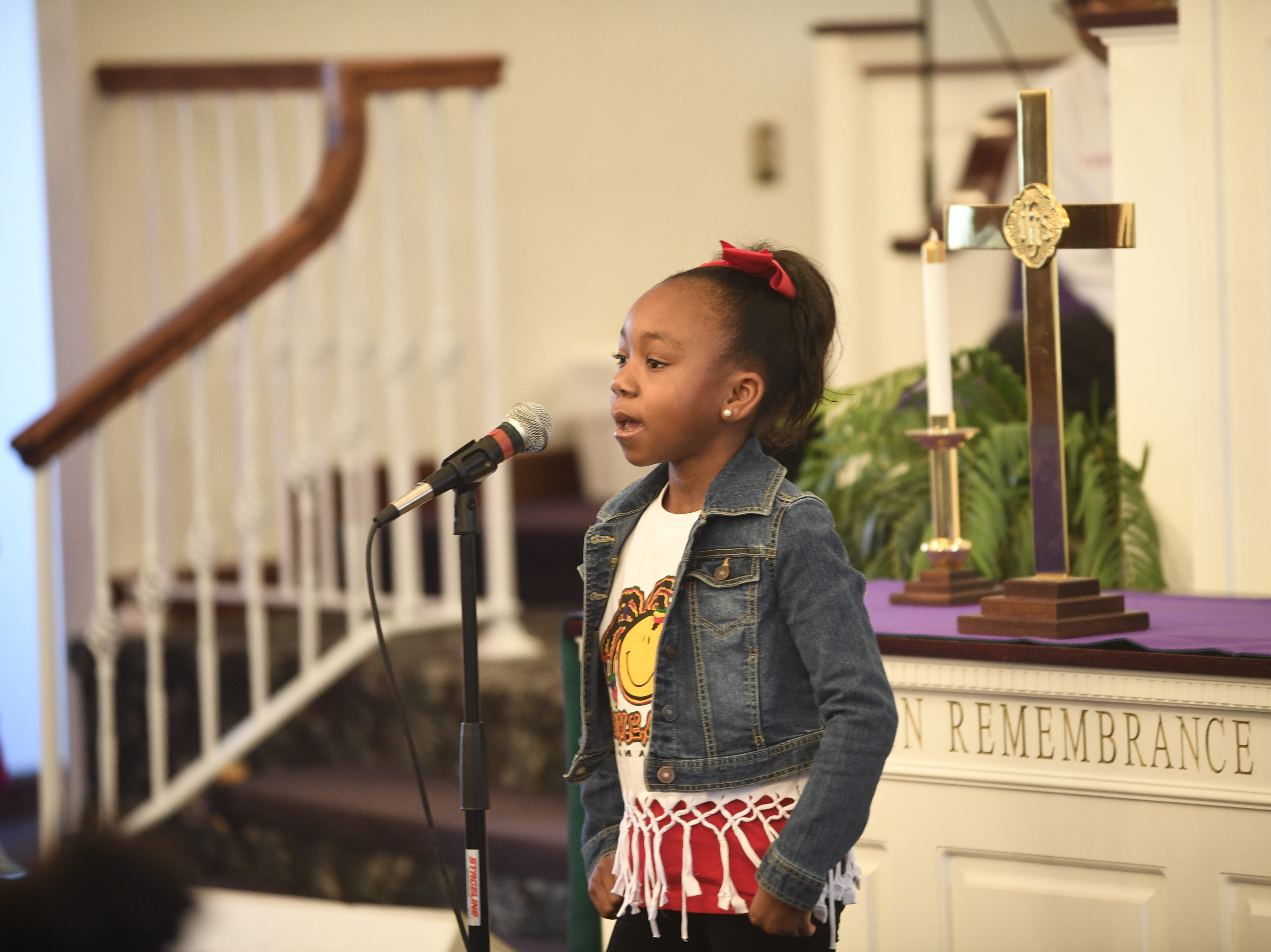 Bremiah Donaldson leads the audience in a song during Mt. Pleasant Church's Black History Month event, in Pinson, Tenn. Feb 24, 2019.