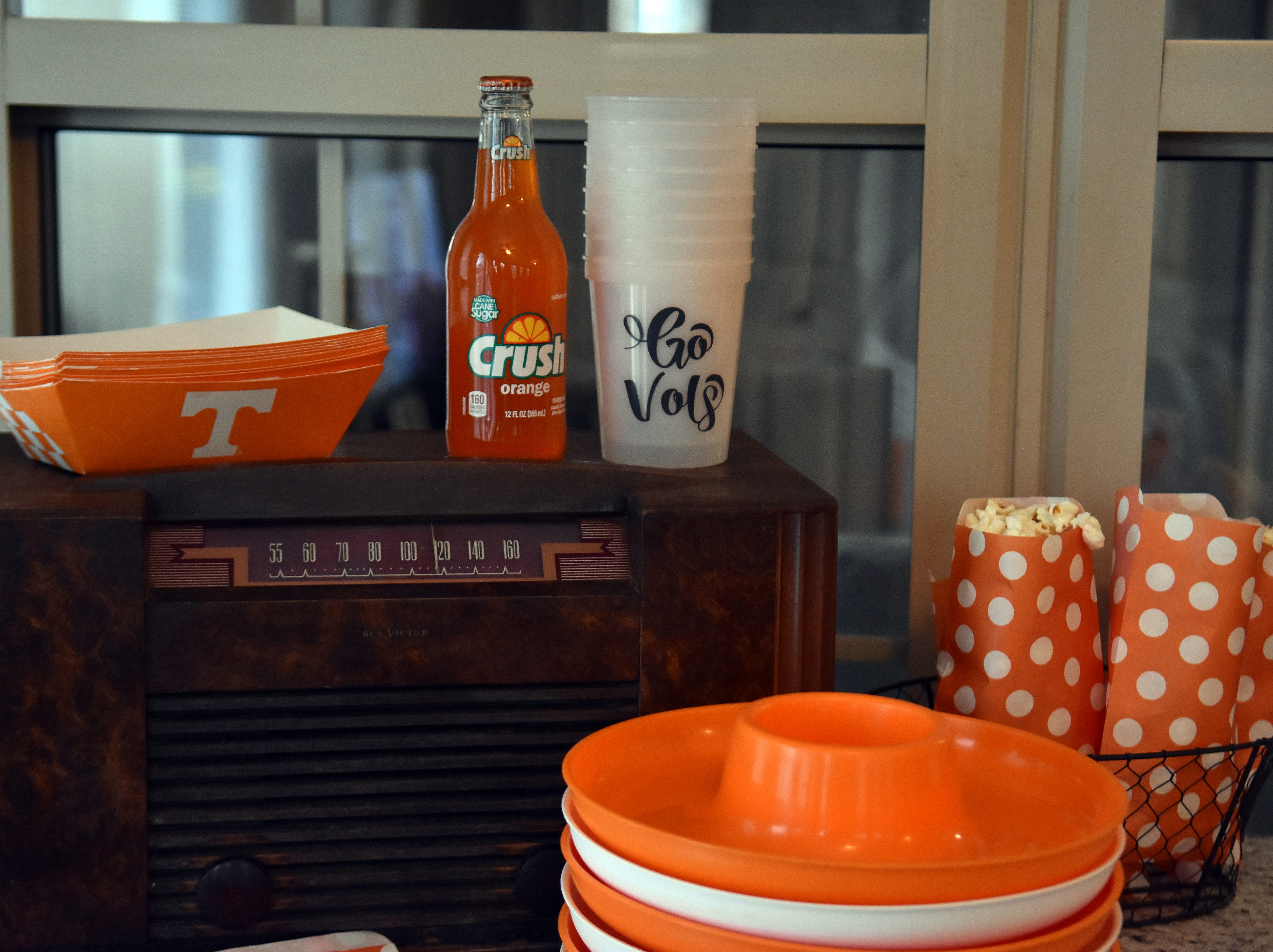 This vintage radio makes an interesting display at a food station. The cups (which turn orange when filled with a cold beverage) can be keepsakes for guests.