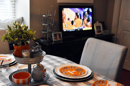 An extra television in the kitchen area allows guests to keep up with game action while they grab food.