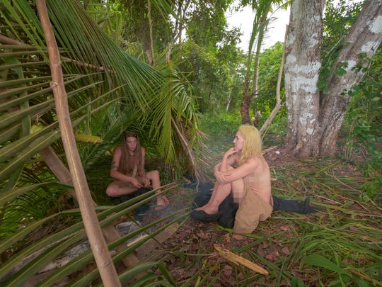 "Maryville's Sara Burkett, right, sits with her survival partner Kate Wentworth on an episode of Discovery Channel's ""Naked and Afraid."""
