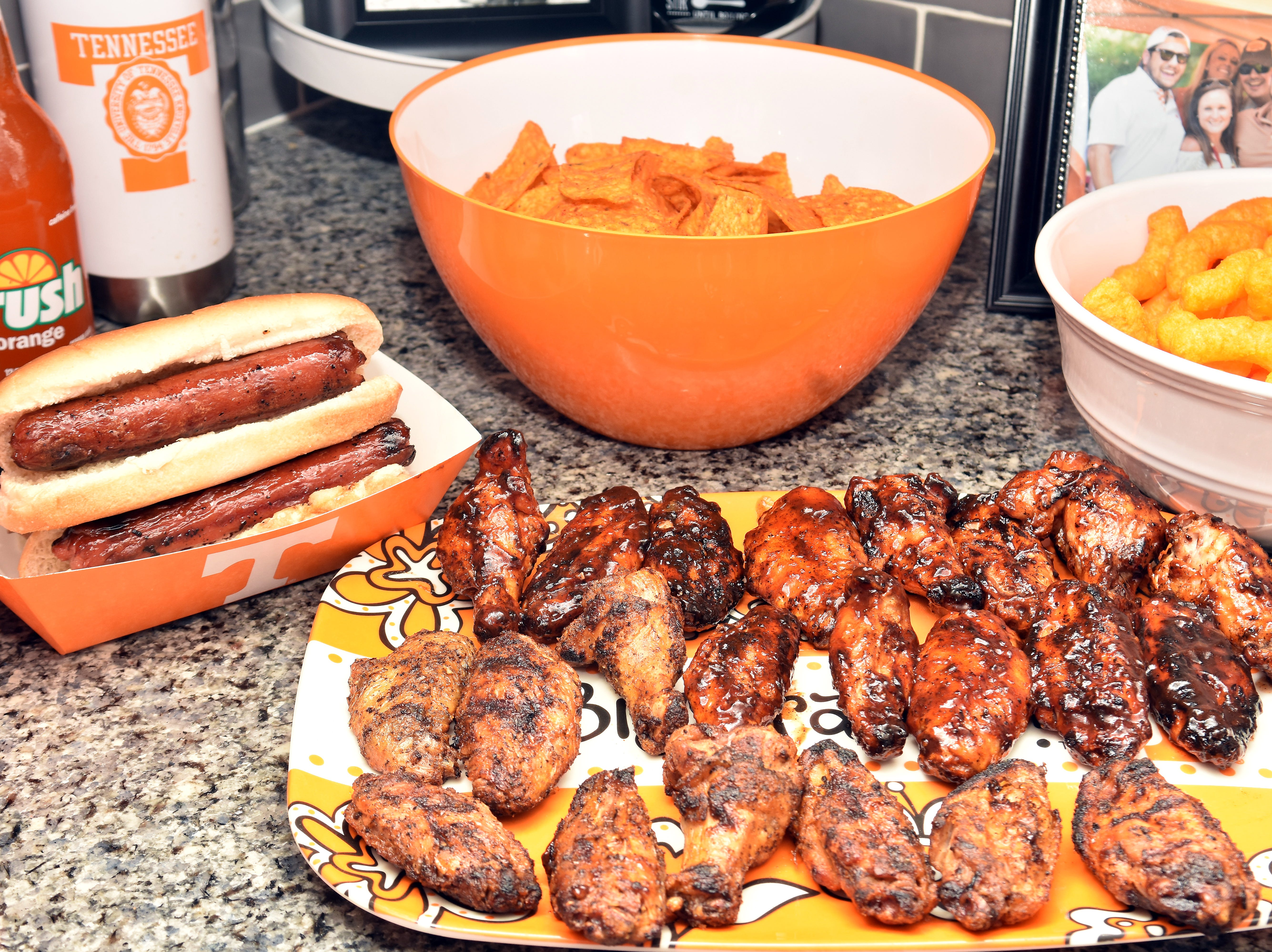 Grab and go foods such as wings or a hot dog bar are good choices for a basketball watching party.