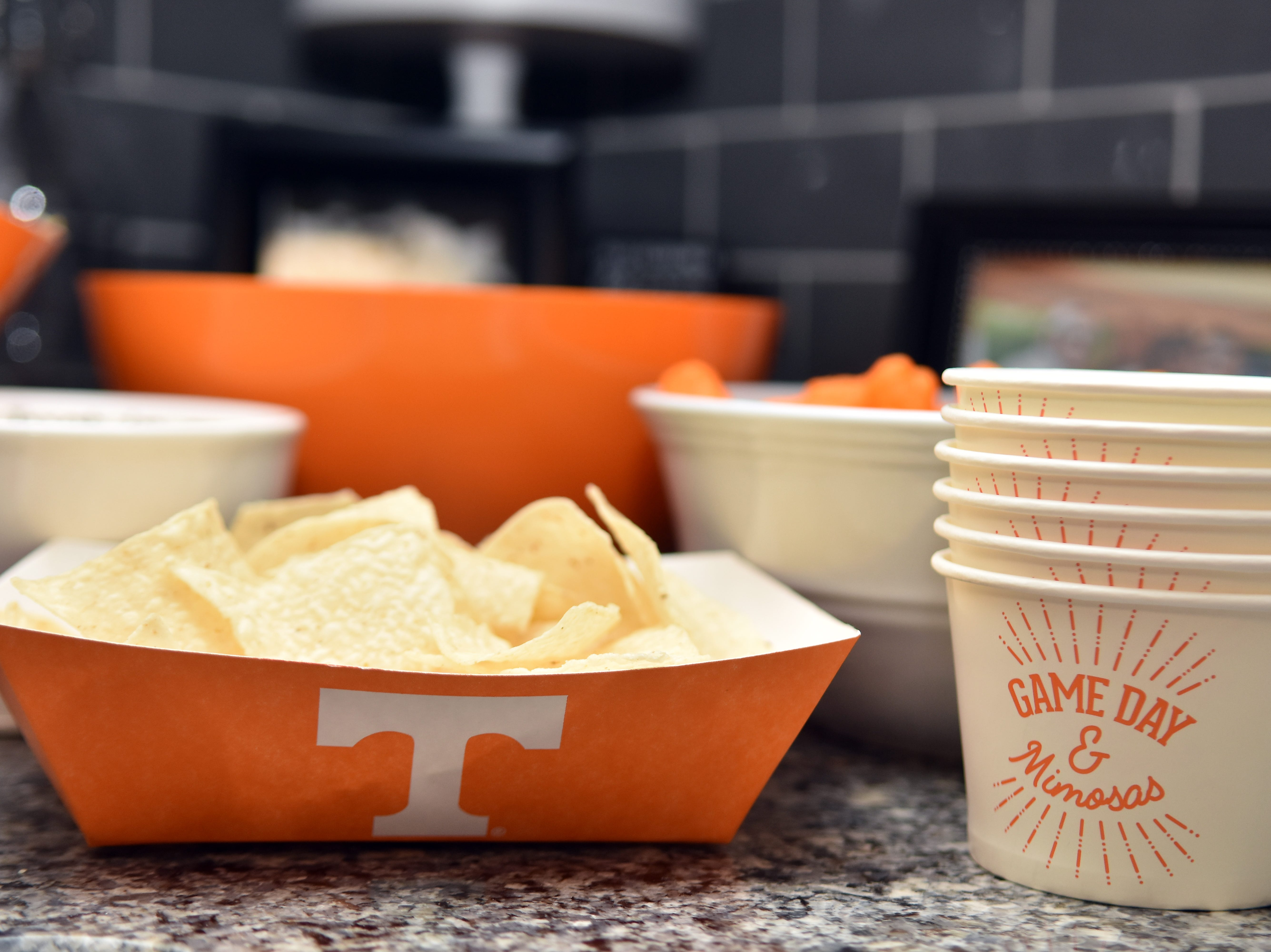Tennessee paper trays are perfect for holding chips or hot dogs and the small paper cups keep queso or salsa in its place.