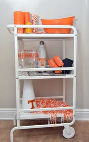 Limited counter space? Set up a utility cart with paper products, beverages or desserts.