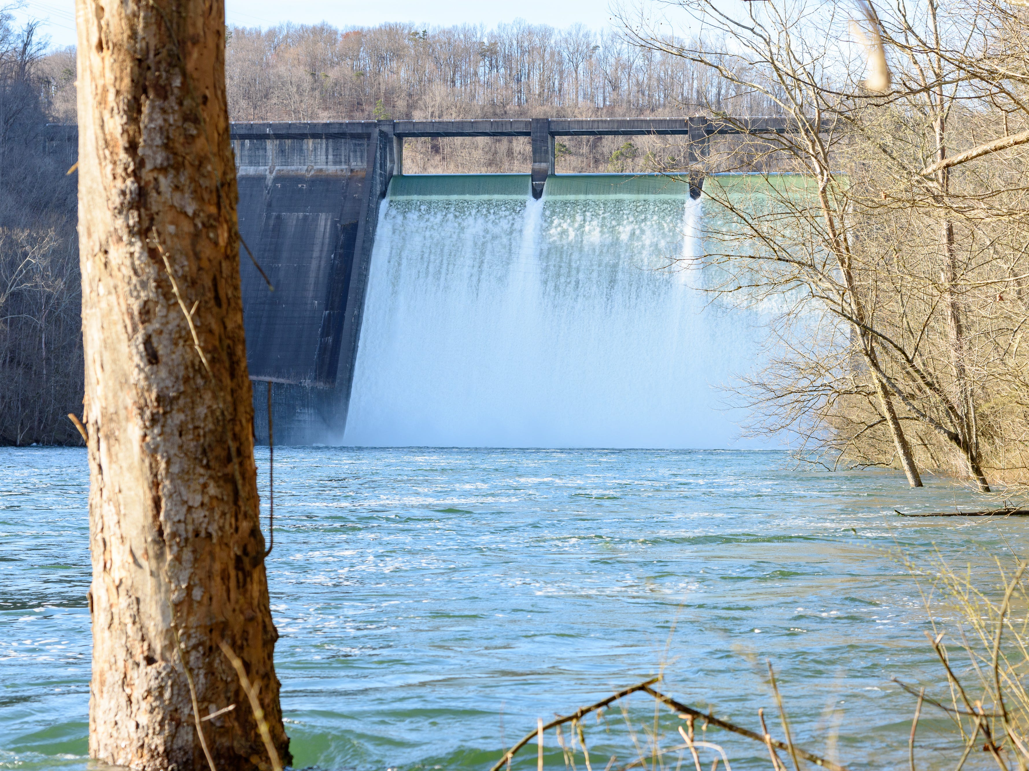 Water spills over the flood gates at Norris Dam in Anderson County on Monday Feb. 25, 2019.