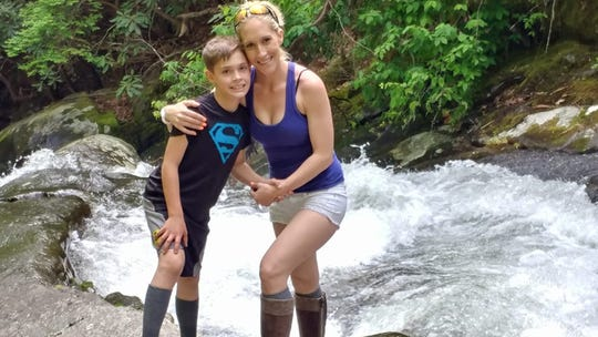 Sara Burkett and her son Austyn pose together during a trip to Tremont.