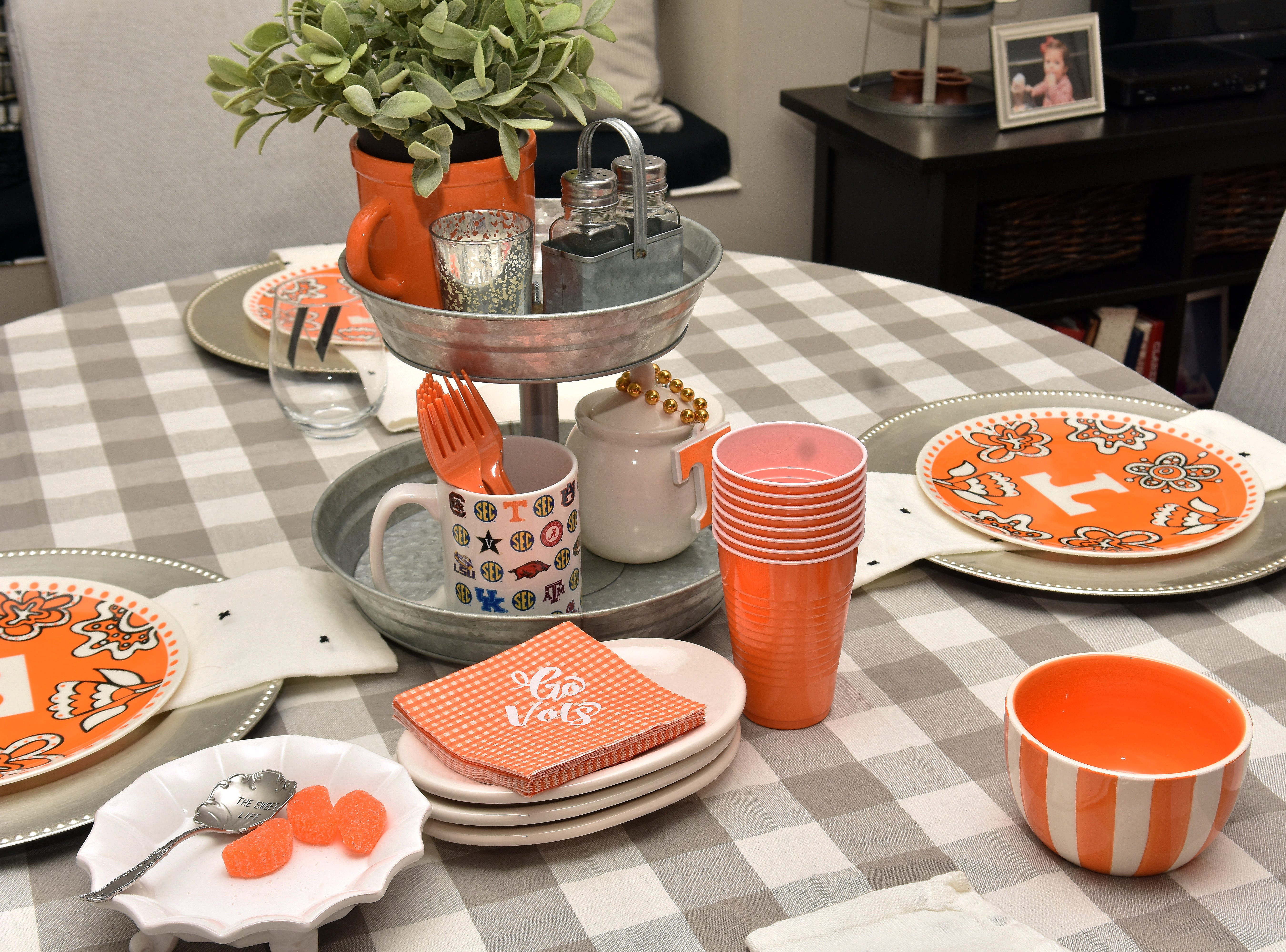 A table set up in the kitchen adds even more color to the party and provides extra seating.