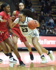 Purdue freshman Kayana Traylor from Martinsville drives hard from the top of the key against Maryland.