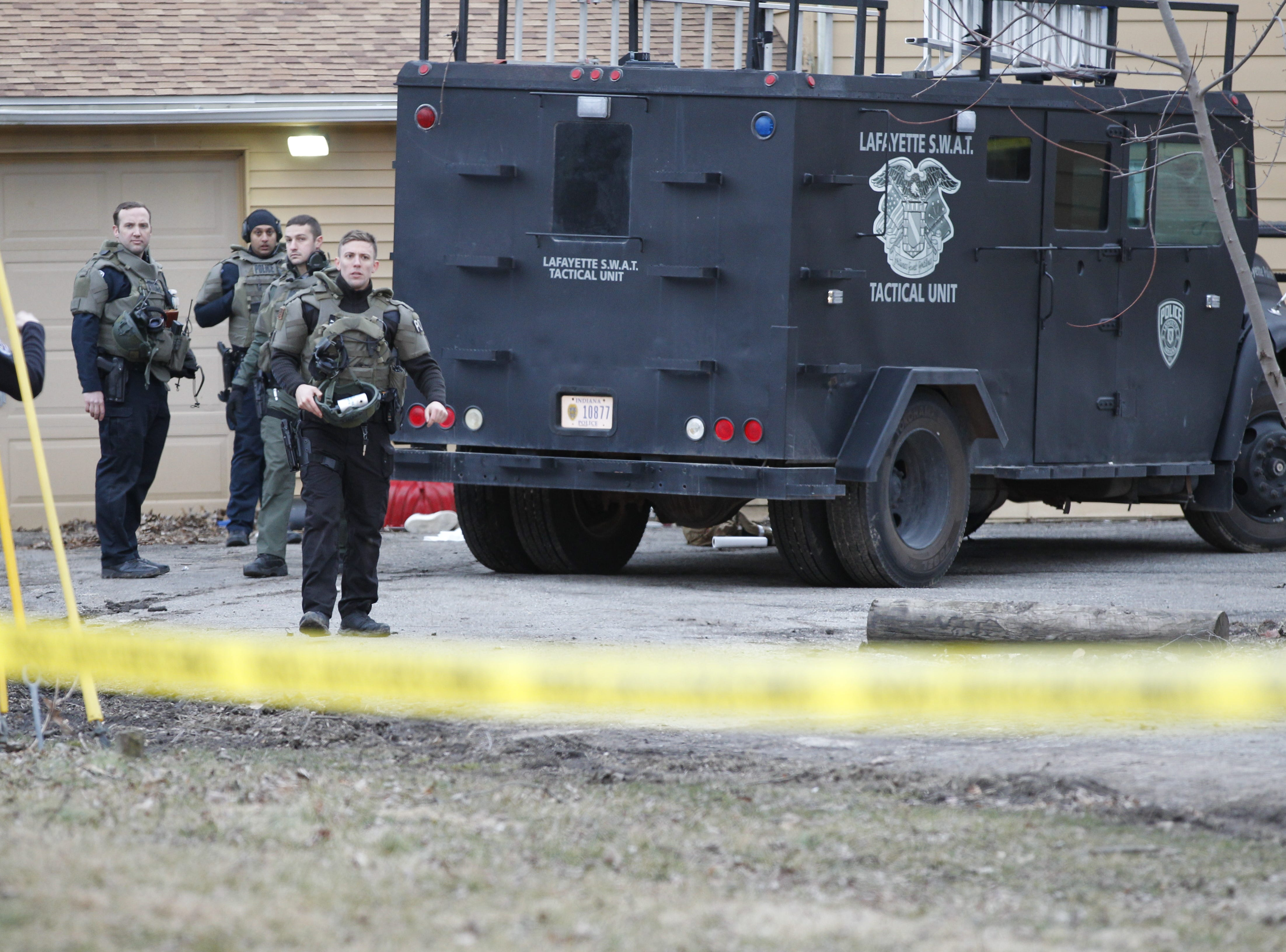 Lafayette police SWAT officers Monday afternoon after the  breaching of a house where 26-year-old Dustin Borders barricaded himself. A SWAT officer shot Borders when officers breached the house. Police have not identified which officer fired his weapon.