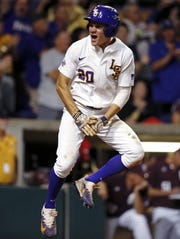 AP LSU's Antoine Duplantis reacts after scoring on a two-run double by Greg Deichmann in the eighth inning Saturday. LSU's Antoine Duplantis reacts after scoring on a two-run double by Greg Deichmann in the eighth inning of an NCAA college baseball tournament super regional game against Mississippi State in Baton Rouge, La., Saturday, June 10, 2017. LSU won 4-3. (AP Photo/Gerald Herbert)