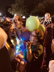 James and Elizabeth Rourk of Lafayette found out their baby is a girl with a Mardi Gras gender reveal party, and pink beads thrown from float No. 13 in the Krewe of Carnivale en Rio parade revealed the surprise Saturday night. Family and friends joined the fun.