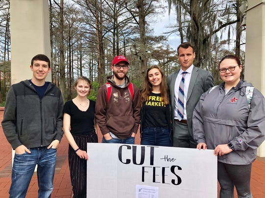 """Members of Young Americans for Liberty at University of Louisiana at Lafayette host a """"Cut the Fees"""" protest on campus Tuesday. They want to start a conversation about student fees. From left are students Triston Myers, Summer Cratty, Caleb Wooton, Maggie Anders, Joshua Baudoin and Carly Taylor."""