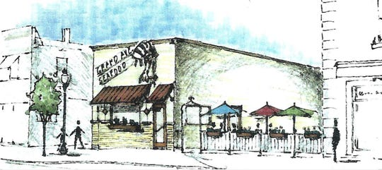 Fowlerville building owner Richard Cheaney had this architectural rendering of a barbecue and seafood restaurant with outdoor seating drawn up more than a decade ago. He wants to make it happen, but only if he can get a liquor license, he said.
