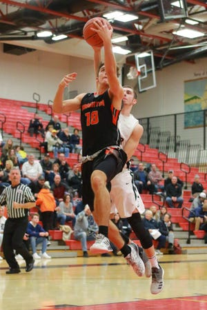Brighton's Keenan Stolz scored 15 points in limited playing time because of foul trouble in a 69-51 district basketball victory over Dexter on Monday, Feb. 25, 2019.