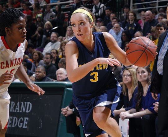 Grand Ledge's Hannah Orwat (3) drives against Canton's Alanna Brown in their MHSAA semifinal game Friday, March 14, 2014, in East Lansing, Mich.