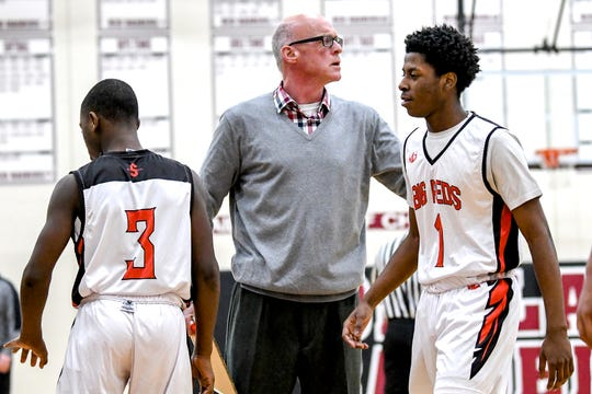 Sexton's head coach Steve Finamore, center, talks with players during a timeout in their game against Portland during the first half on Monday, Feb. 25, 2019, at Portland High School.