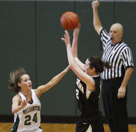 Payton Birchmeier is fouled while shooting in a game against Williamston in 2014.