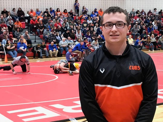 A serious knee injury could have ruined Sam Krupa's senior year of football and wrestling, but he and the tight-knit Lucas community would not let that happen.