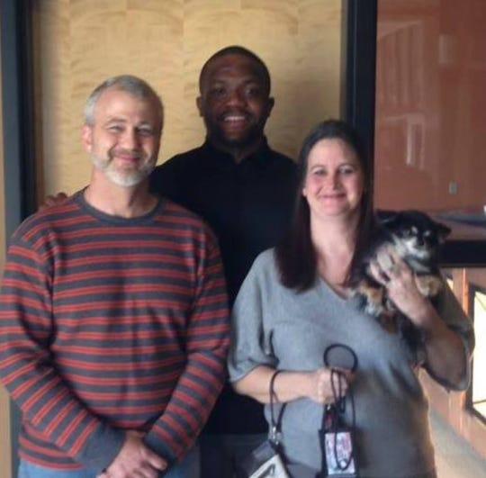 Dennis and Patricia Duffer, holding Emperor Rajesh, pose with former Ohio State football star Maurice Clarett.