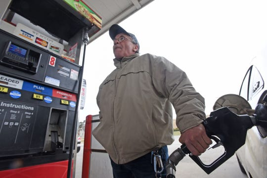 Sandy Gentile pumps gas Tuesday at Speedway on Park Avenue West. Gentile and many motorists are not happy about Ohio's proposed 18-cent per gallon gas tax hike.