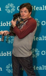 Emperor Rajesh, seen here with Michael J. Fox, was a trained cardiac alert chihuahua. He passed away Feb. 17, 2019.