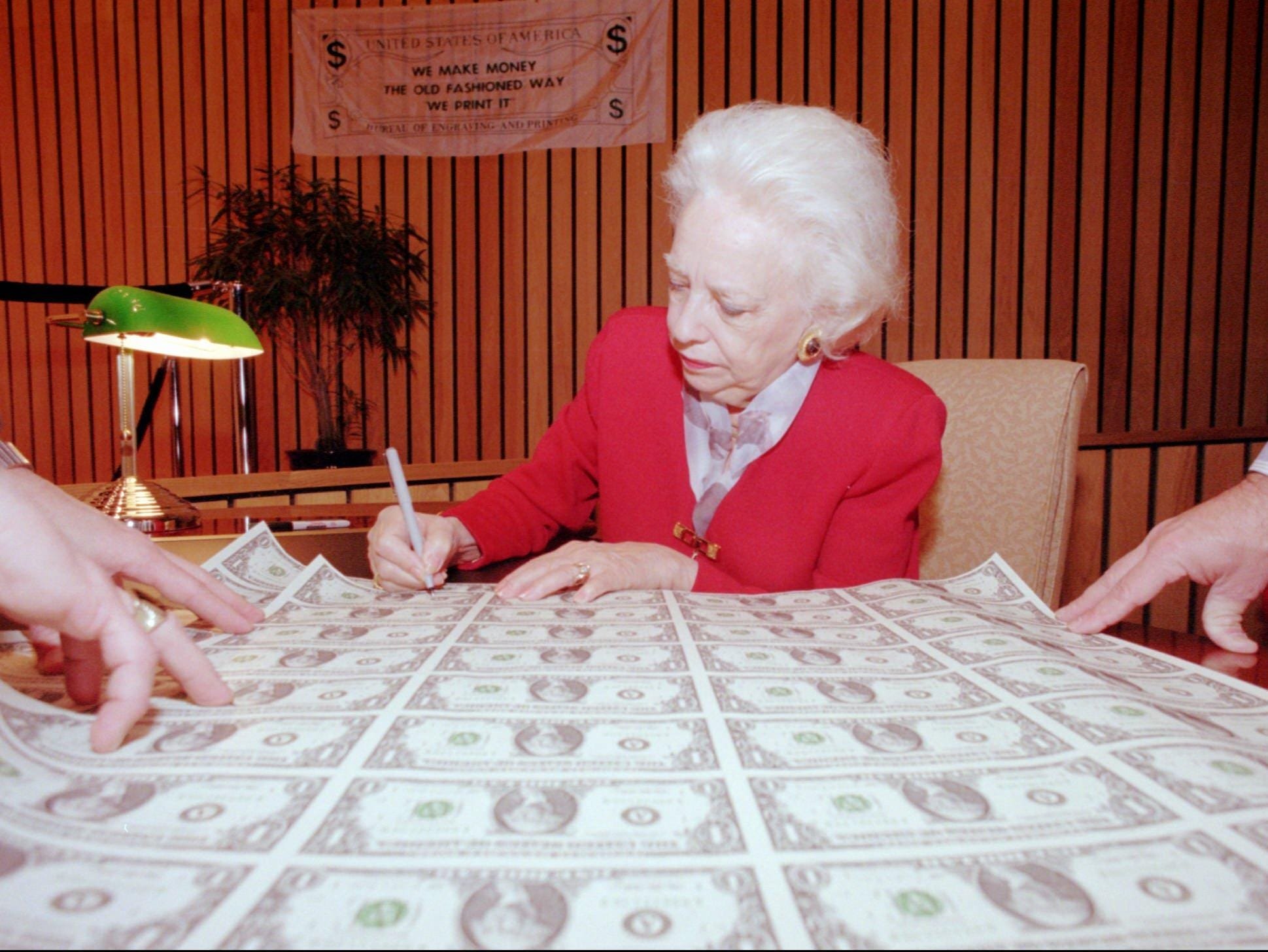 Mary Ellen Withrow, Treasurer of the United States, signs a sheet of uncut one dollar bills during her visit to the Federal Reserve Bank in Boston Thursday, Nov. 20, 1997. Withrow was at the Federal Reserve Bank to promote sales of uncut currency that will be availiable to the public Friday as possible holiday gifts. (AP Photo/Gail Oskin)