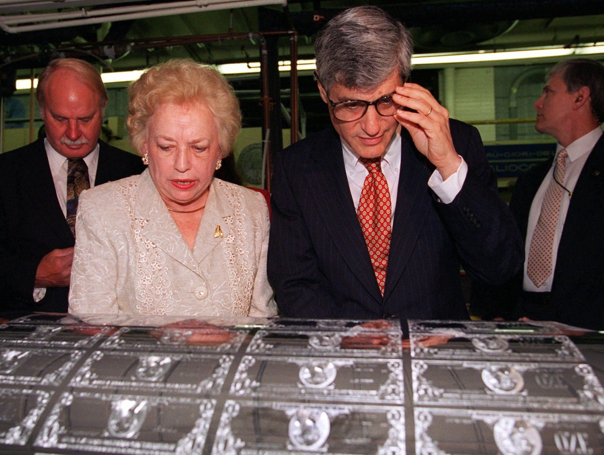 Treasury Secretary Robert Rubin and Treasurer of the U.S. Mary Ellen Withrow look over plates for printing dollar bills featuring their signatures, Friday, May 5, 1995, at the Bureau of Printing and Engraving in Washington. The officials were on hand to watch the first printing of bills with their signatures. (AP Photo/Dennis Cook)