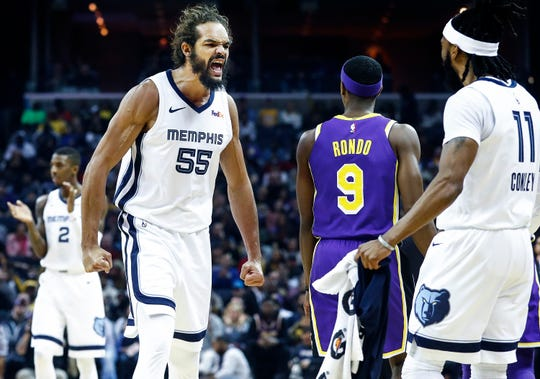 Memphis Grizzlies forward Joakim Noah (left) celebrates during a break in action against the Los Angles Lakers at the FedExForum in Memphis, Tenn., Monday, February 25, 2019.