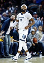 Memphis Grizzlies fans celebrate after guard Mike Conley made a layup while being fouled by the Los Angles Lakers defense during action at the FedExForum in Memphis, Tenn., Monday, February 25, 2019.
