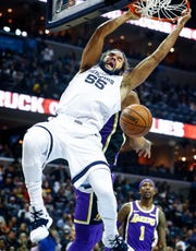 Memphis Grizzlies forward Joakim Noah (right) dunks over the Los Angles Lakers defense during action at the FedExForum in Memphis, Tenn., Monday, February 25, 2019.