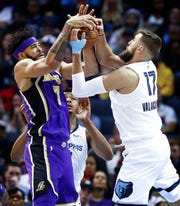 Memphis Grizzlies center Jonas Valanciunas (right) battles Los Angles Lakers defender JaVale McGee (left) for a rebound during action at the FedExForum in Memphis, Tenn., Monday, February 25, 2019.