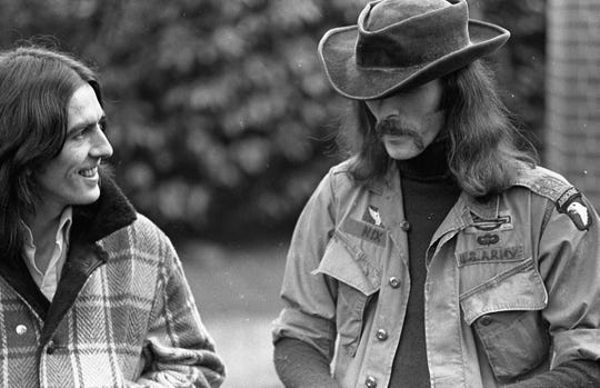 Don Nix with George Harrison, left, at the ex-Beatle's home at Henley-on-Thames, England, 1974.