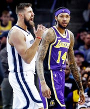 Memphis Grizzlies center Jonas Valanciunas (left) reacts after missing a layup after being fouled by Los Angles Lakers forward Brandon Ingram (right) during action at the FedExForum in Memphis, Tenn., Monday, February 25, 2019.