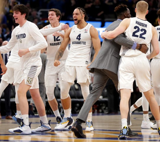 Marquette's Theo John (4) is pumped up after beating Villanova on Feb. 9.