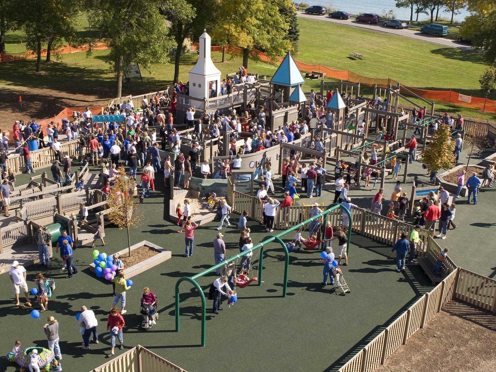Kids with disabilities and without disabilities enjoy playing at Possibility Playground in Port Washington.