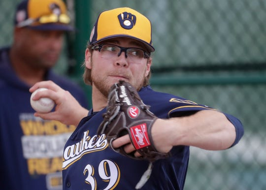 Corbin Burnes throws during a spring training workout last week. On Tuesday, the right-hander allowed no runs in an inning of work against the Padres.