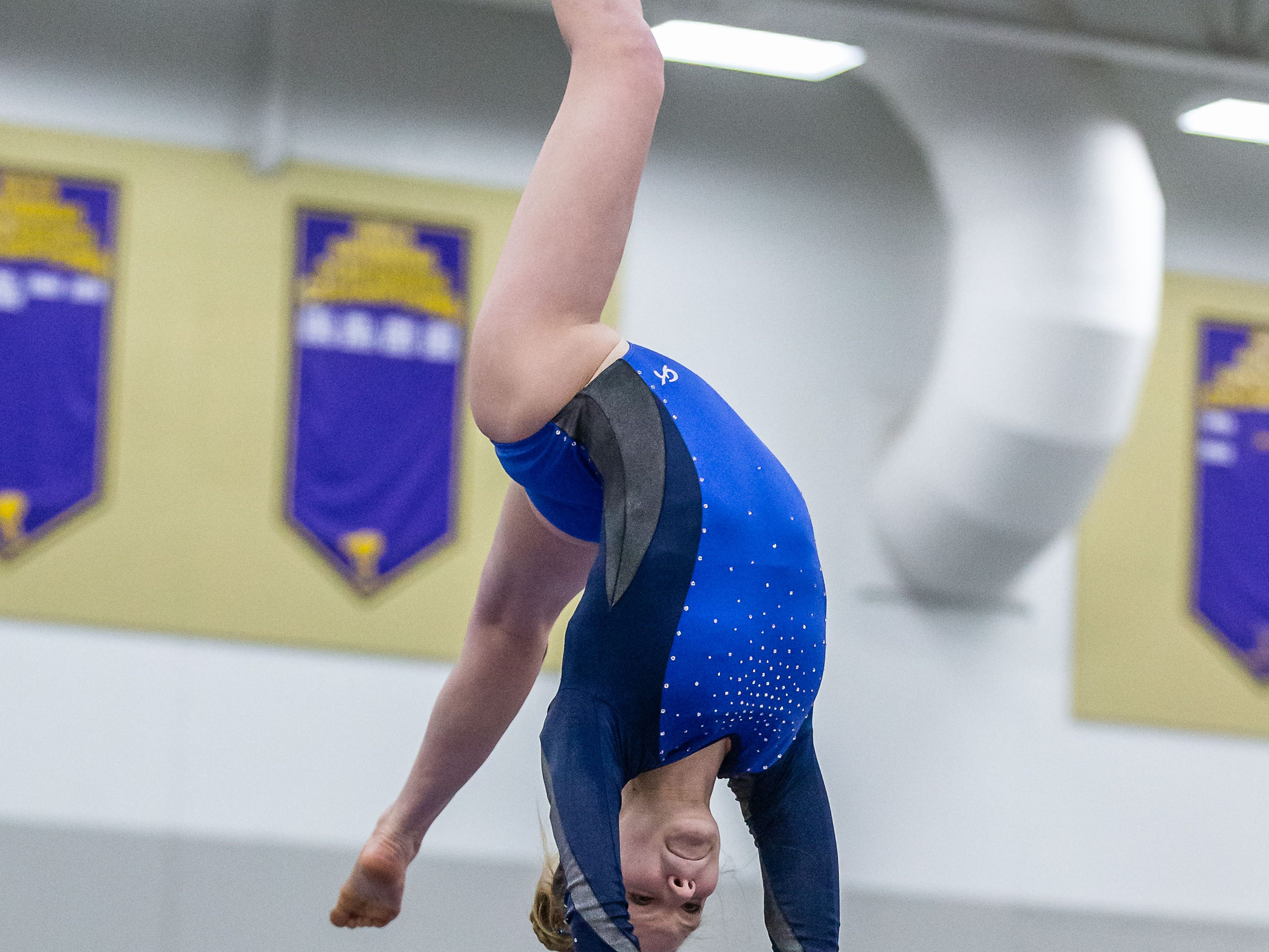 Brookfield co-op gymnast Sophie Latona competes on the beam during the Division 1 sectional at Oconomowoc on Friday, Feb. 22, 2019. Latona placed fifth on the beam.