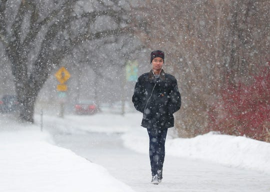 Paul Lewis of Milwaukee walks through the snow along North Lincoln Memorial Drive in Milwaukee on Tuesday. Another 2 to 5 inches of snow is forecast in southern Wisconsin Tuesday afternoon into Wednesday. A winter weather advisory is in effect from 5 p.m. Tuesday to 9 a.m. Wednesday.