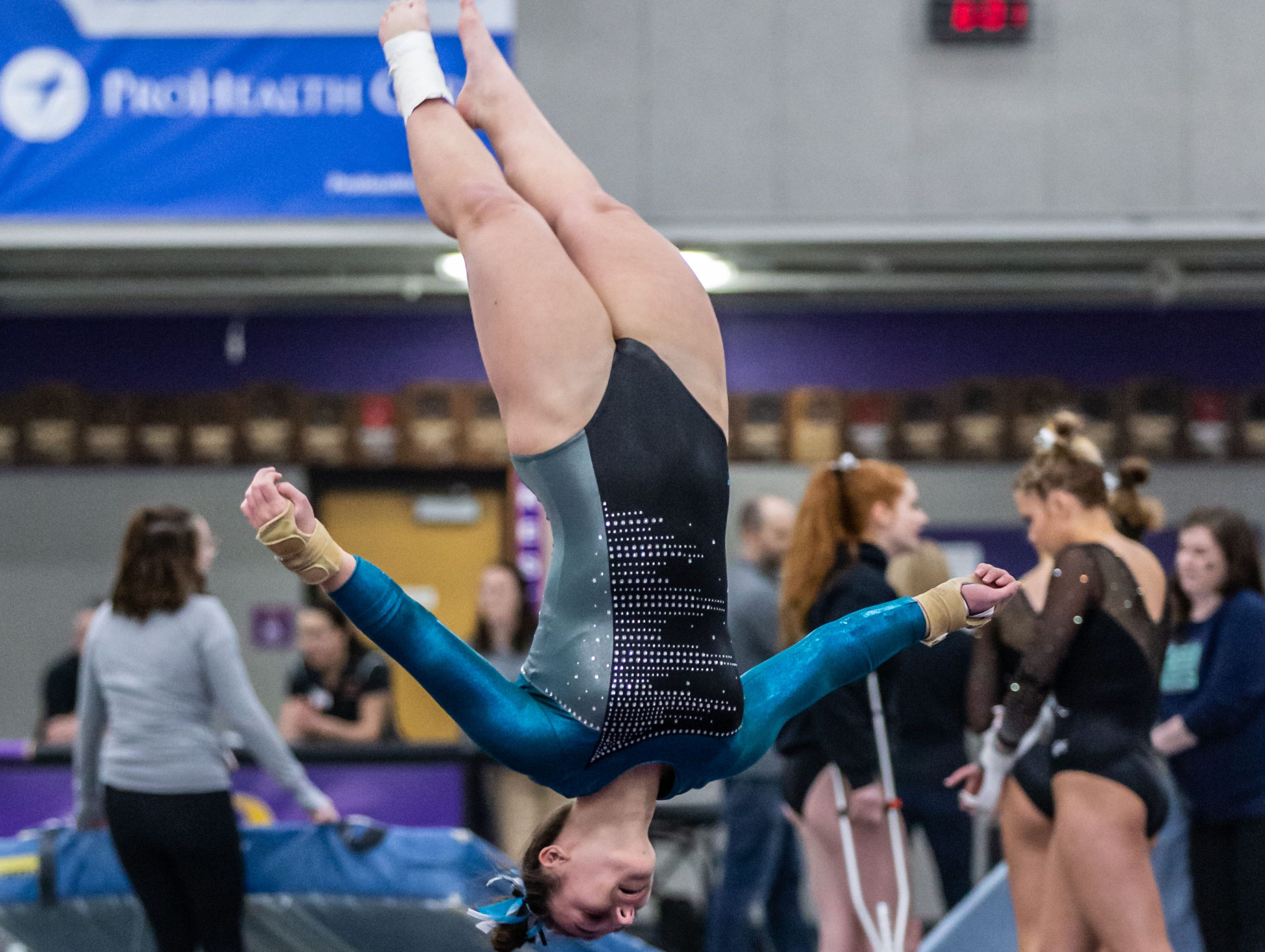 Menomonee Falls co-op gymnast Madeline Durand competes on the floor during the Division 1 sectional at Oconomowoc on Friday, Feb. 22, 2019.