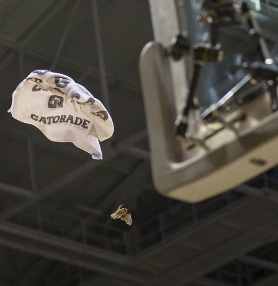 Players throw a towel at a bat flying in the Bradley Center during the second half of the game between Providence and Marquette on Jan. 26, 2013. (Marquette won, 81-71.)