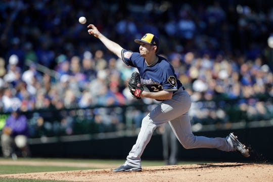 Brewers pitcher Zach Davies throws during a spring training game last week.